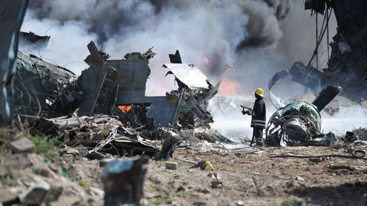 fireman putting out fires at a plane crash